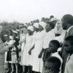 Warren Metzler with baptism class, Jamaica, 1957 (VMC Archives)