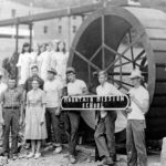 Virginia Mennonite Conference youth workgroup at Grundy, Va., an orphanage, restoring waterwheel (VMC Archives)