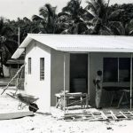 Working on parsonage at Retreat, Jamaica, with Calvary Church in background, 1969 (VMC Archives)
