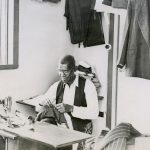 Simeon Walters works in his tailor shop, Jamaica (VMC Archives)