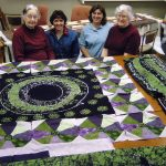 Quilt made from African fabric through Sister link with women in Arusha, Tanzania - Gladys Driver, Yvonne Martin, Jan Kauffman, and Brownie Driver (Dorothy Krieder photo)